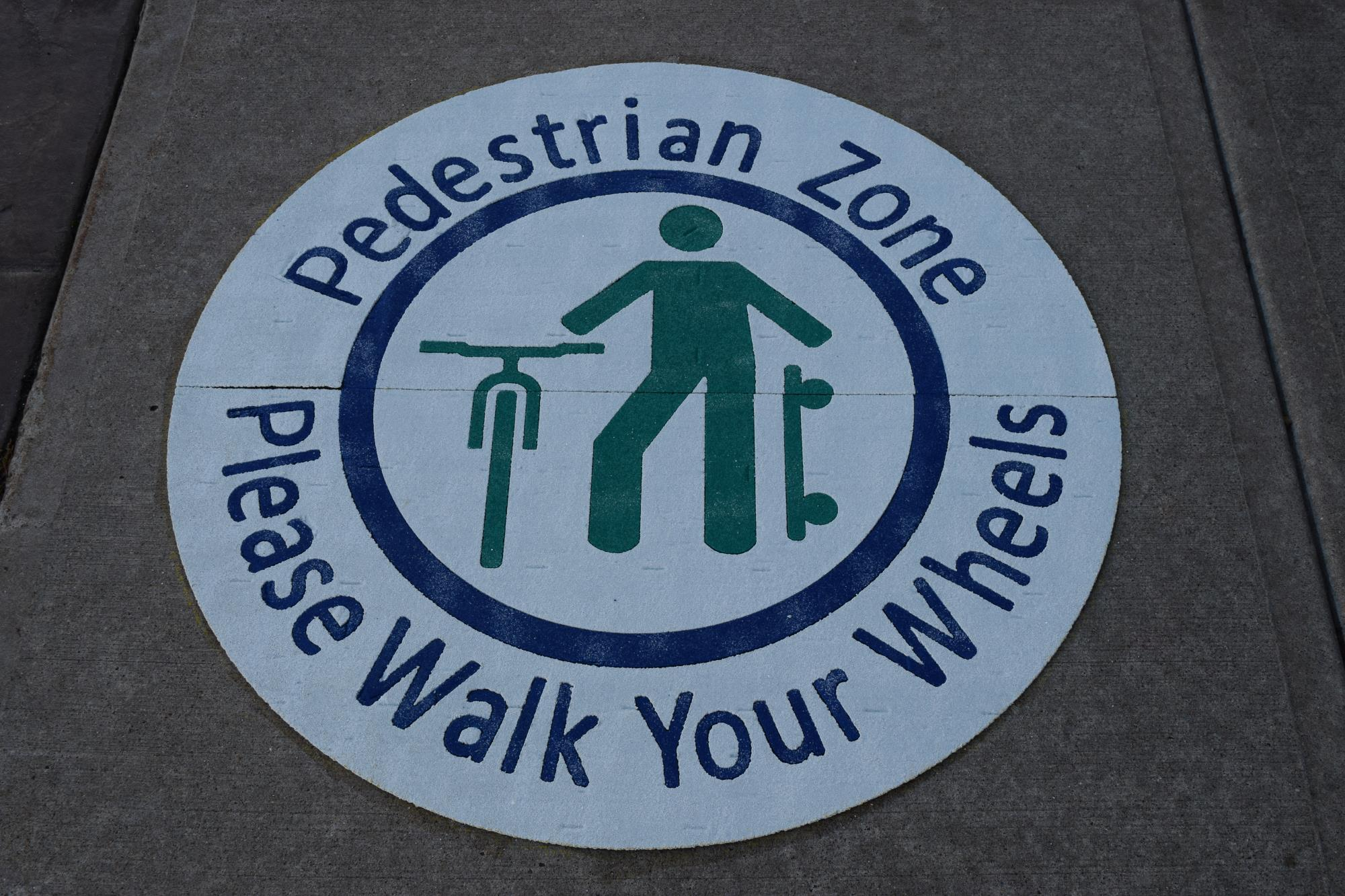 Walk your wheels sign